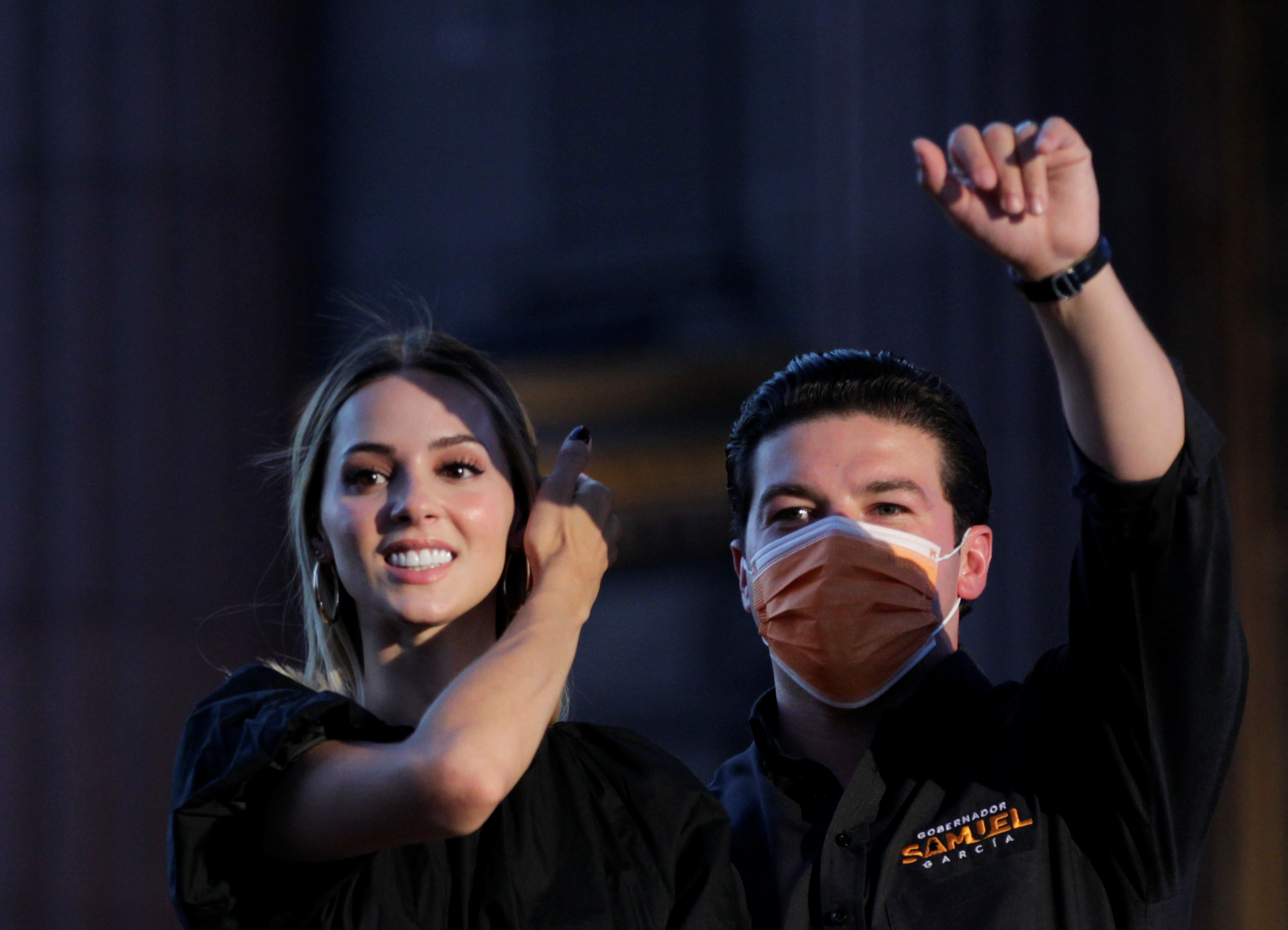 Samuel Garcia, Citizen Movement party's candidate for governor in the state of Nuevo Leon, addresses supporters next to his wife Mariana Rodriguez, a day after the mid-term elections, during a celebration at the Macroplaza in Monterrey, Mexico June 7, 2021. REUTERS/Daniel Becerril